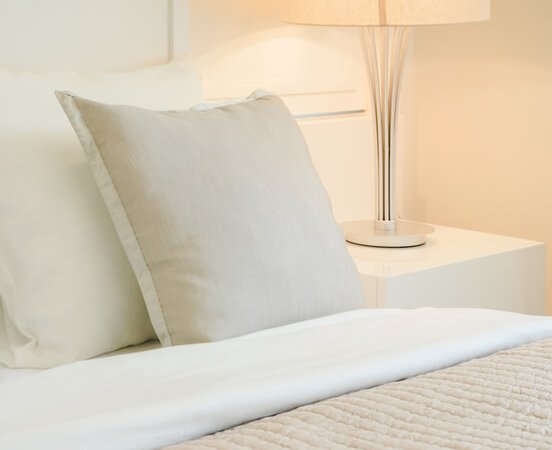 Beige Pillow On Comfy Bed